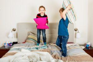 Kids playing pillow fight