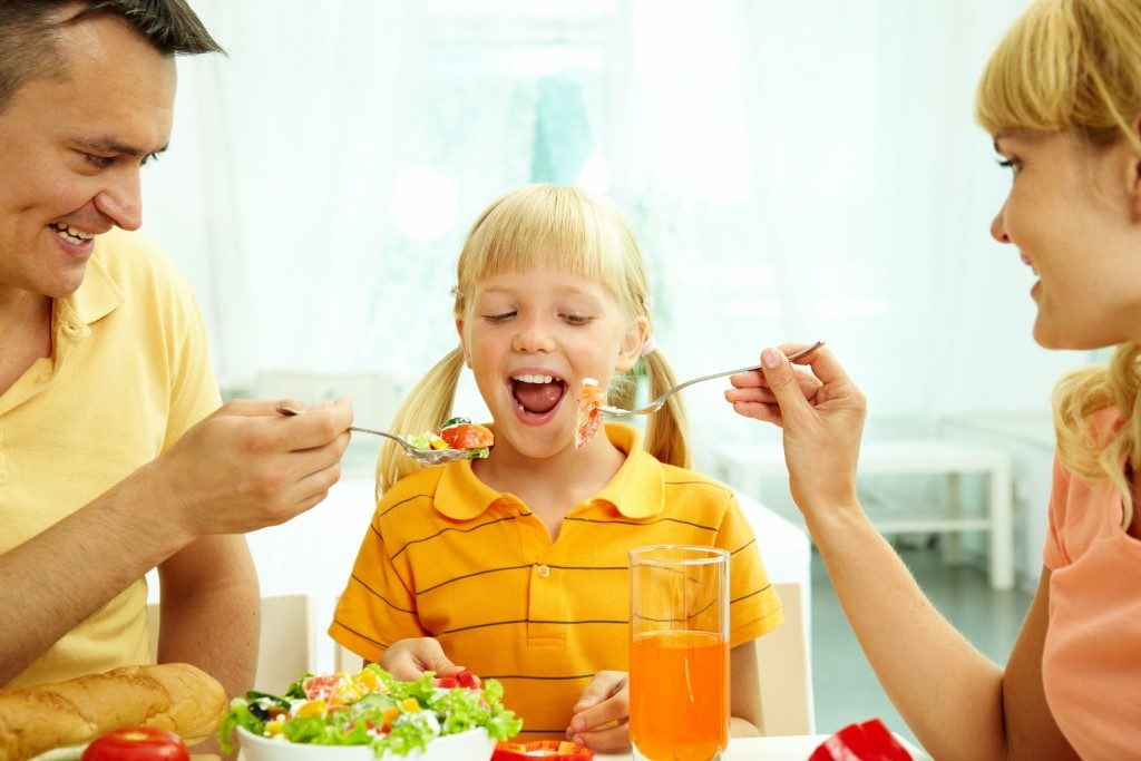 Parents feeding a child