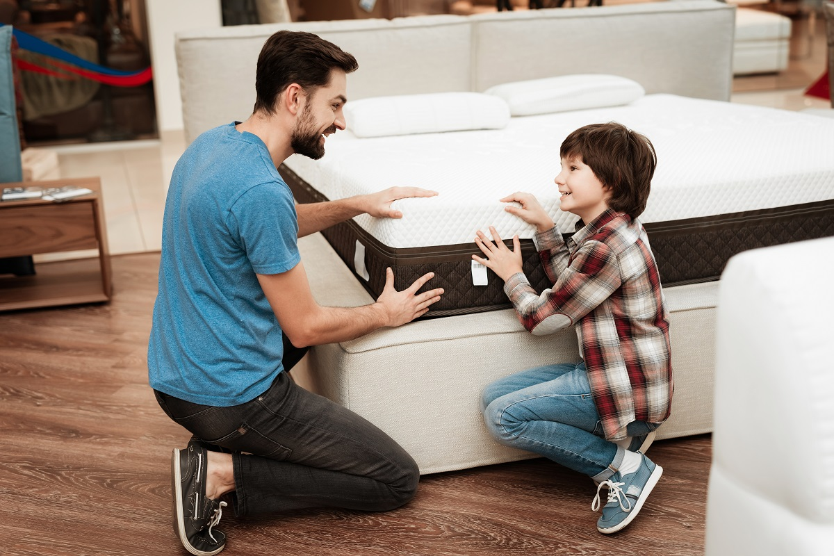 Father and son choosing a mattress