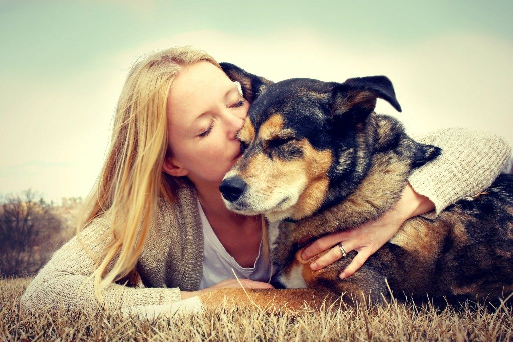 Woman and German Shepherd