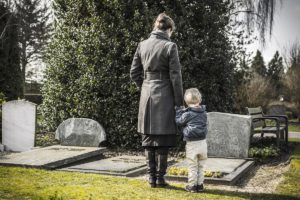 Woman and child at the graveyard