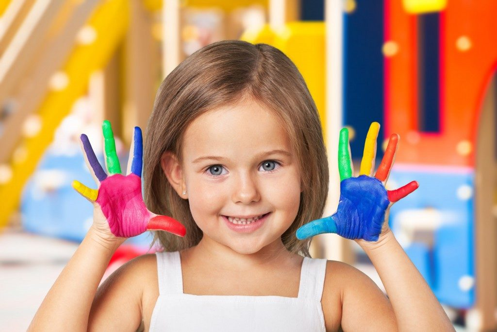 Little girl with painted hands