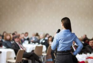 woman speaking on conference