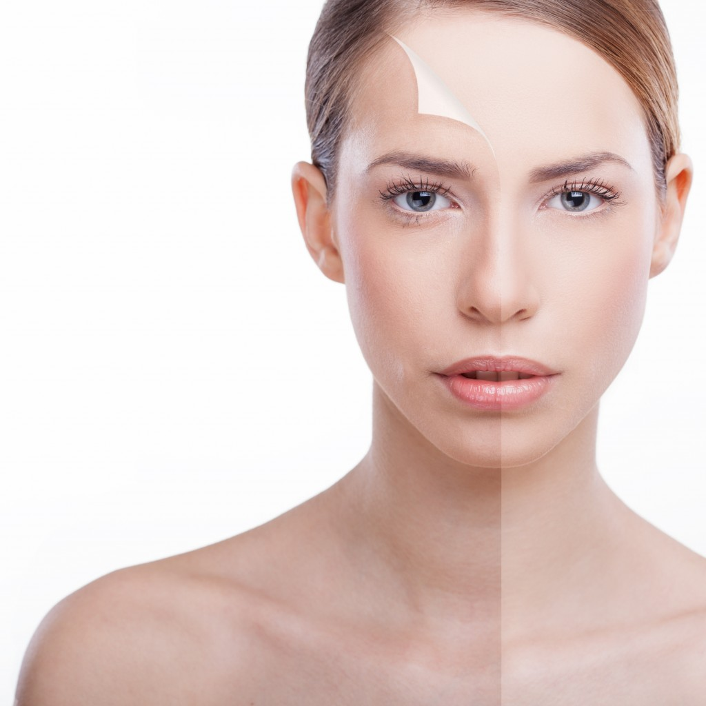 Beautiful woman presenting 'peeling back' anti-aging concept. Beauty treatment.