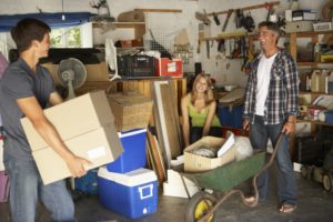 Family clearing the garage