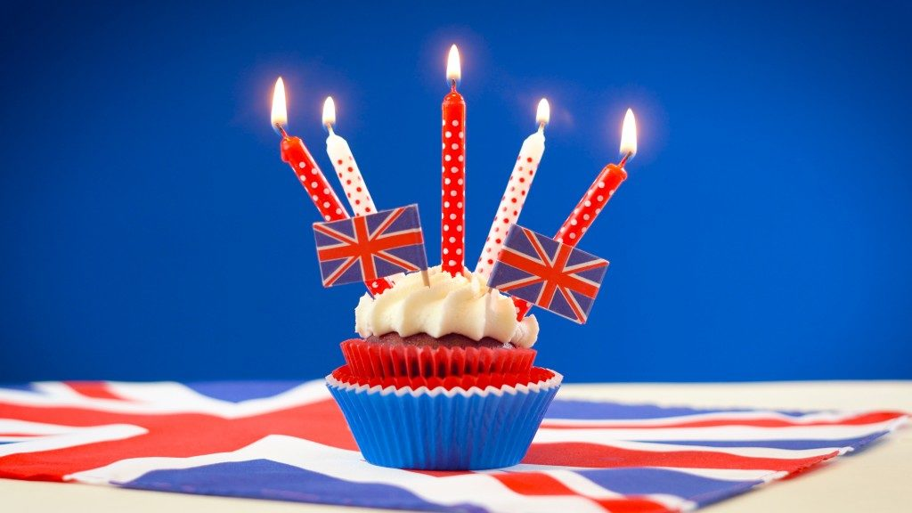 Red white and blue theme cupcakes and cake stand with UK Union Jack flags for Queen's Birthday