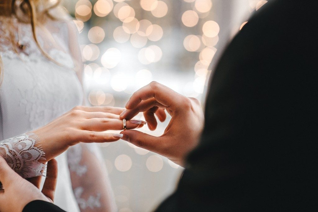 wedding photo of putting on the ring
