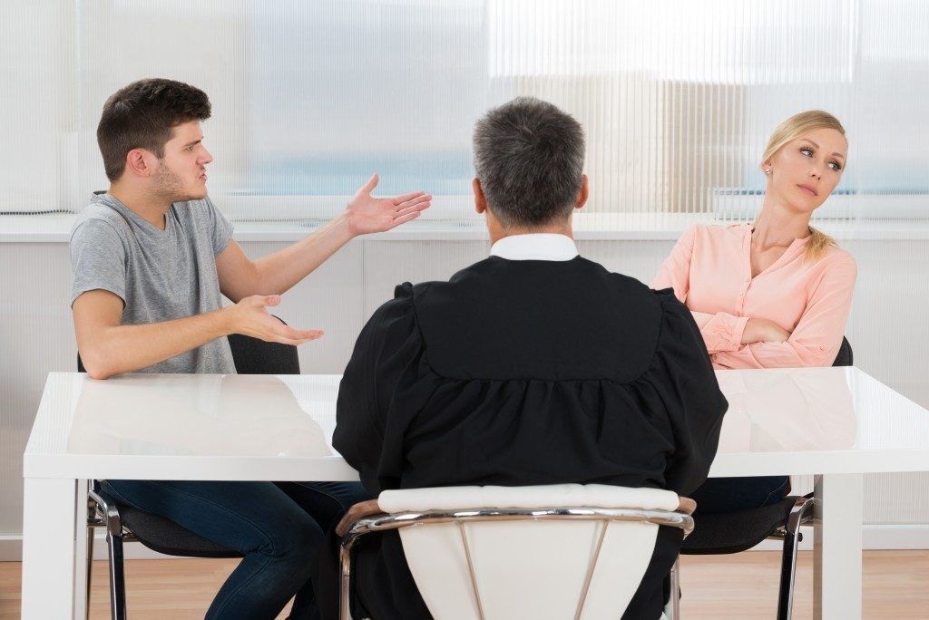 couple quarelling in front of a counselor
