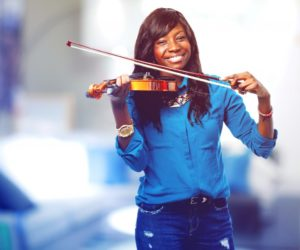 cool black woman playing the violin