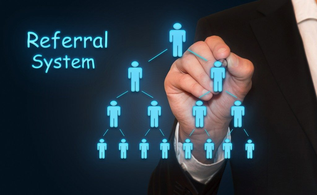 Businessman drawing Referral system concept