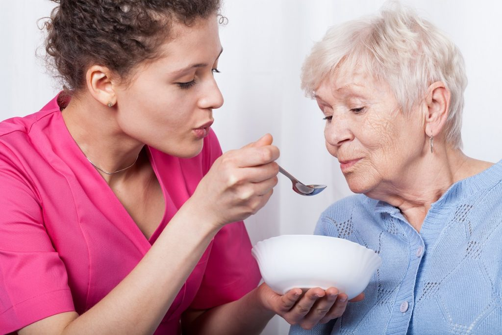 nurse feeding elderly
