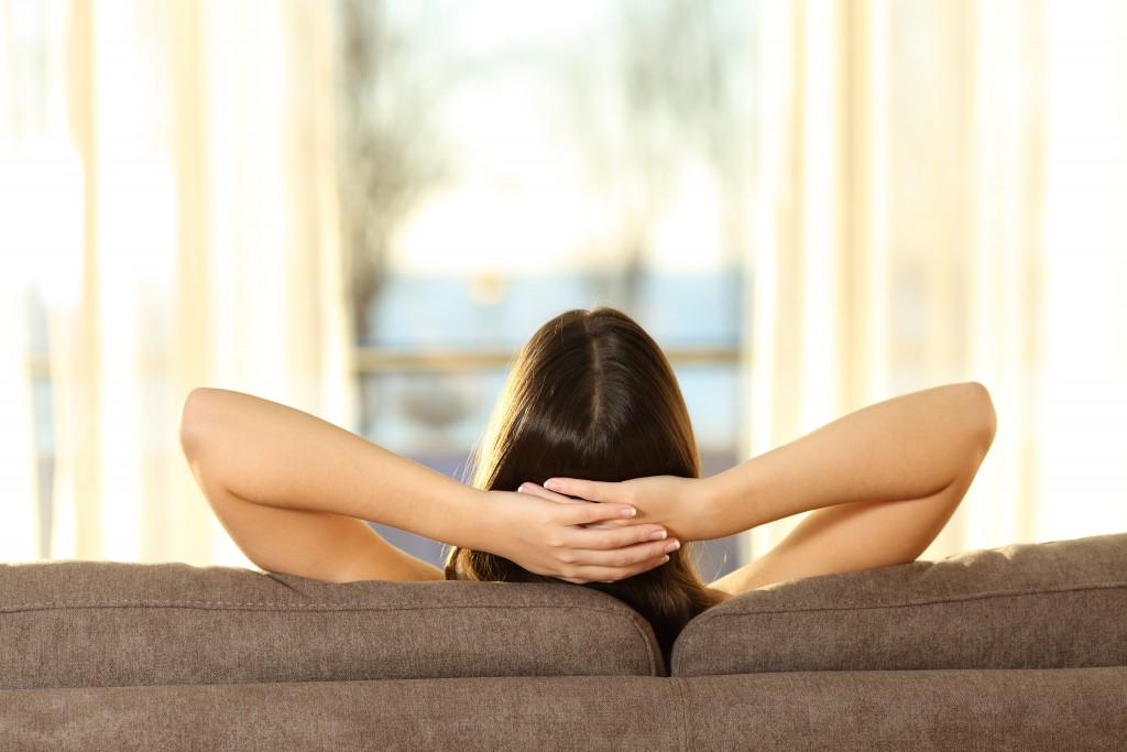 woman relaxing in her couch