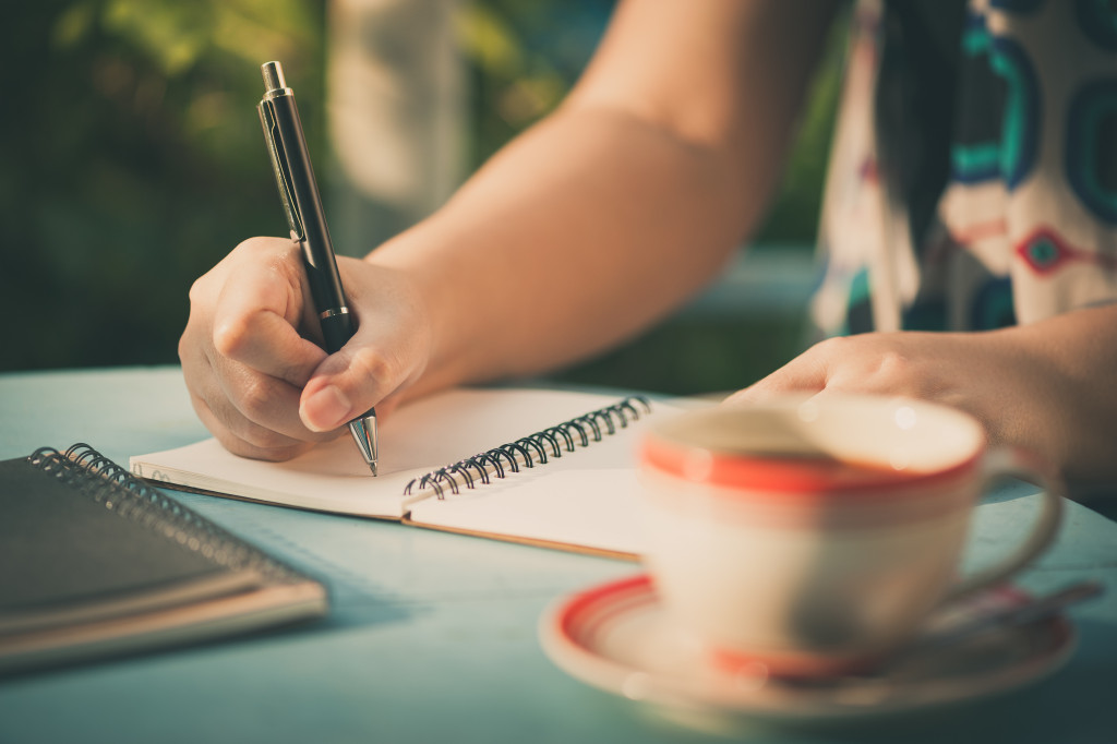 writing on a notebook